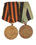 Medalhas para a vitória sobre Alemanha e para a libertação de Belgrado Isolado no branco Editorial ilustrativo imagens de stock royalty free