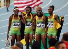 Medalhistas de prata jamaicanos da equipe dos 400 medidores de r Fotografia de Stock