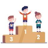 Medalists kids standing on winner podium Royalty Free Stock Photos
