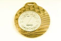Medalj på den vita bakgrunden Royaltyfria Bilder