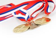 medaljer tre Arkivfoton