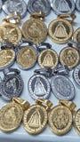 Medaljvirgen royaltyfria bilder