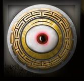 Medallón con el ojo bajo la forma de escudo Fotos de archivo libres de regalías