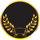 Medalla con una ramificación de oro del laurel. Foto de archivo