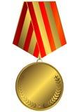 Medalla de oro con la cinta rayada Foto de archivo libre de regalías