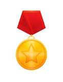 Medalla de oro del premio con la cinta roja Imagenes de archivo