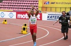 Medalla de oro del triunfo de LALU MUHAMMAD ZOHRI Indonesia en 100 metrs en el campeonato del mundo U20 de IAAF en Tampere, Finla foto de archivo libre de regalías