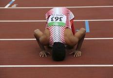 Medalla de oro del triunfo de LALU MUHAMMAD ZOHRI Indonesia en 100 metrs en el campeonato del mundo U20 de IAAF en Tampere, Finla imagen de archivo