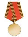 Medalla de oro en blanco fotos de archivo libres de regalías