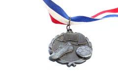 Medalla de plata del fútbol Imagenes de archivo