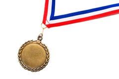 Medalla en una cinta roja, blanca y azul Imagenes de archivo