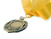 Medalla y cinta de oro Fotografía de archivo libre de regalías