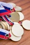 Medallas de oro Imágenes de archivo libres de regalías