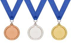 Medallas de oro de plata de bronce genéricas en blanco. Fotos de archivo libres de regalías