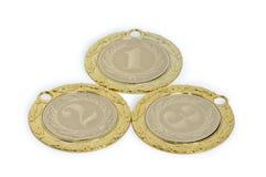 Medallas para los ganadores de eventos que se divierten aislados en un backgr blanco Foto de archivo libre de regalías