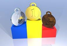 Medallas rumanas en un podium Foto de archivo libre de regalías