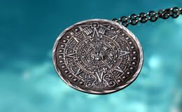 Medallion. Silver medallion by a pool royalty free stock photo