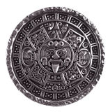 Medallion engraved with the Mayan calendar. On a white background Royalty Free Stock Photos