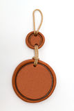 Medallion of red clay. Blank medallion of red clay on a thick rope. Frame Stock Images