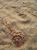 Medallion on sand. Stock Photo