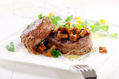 Medallions of fillet steak with wild mushrooms royalty free stock photos