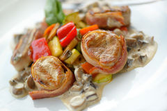 Medallions grilled with vegetables Royalty Free Stock Image
