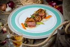 Medallions of meat with bacon. stock photography