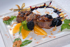 Medallions from pork with oranges Royalty Free Stock Photo
