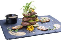 Medallions of veal with asparagus and white mushrooms stock images