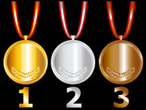 Medals. Three medals with gold, silver and bronze and numbers separate numbers for more options on black background Stock Image