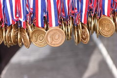 Medals. Editorial image: Gold medals awarded to the participants of Hervis Half Marathon run in Prague, March 28, 2008. Winner of the half marathon was Eliah Royalty Free Stock Photos