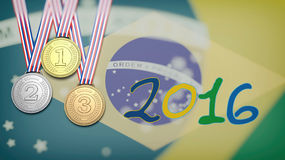 Medals against of Brazil flag and 2016 year Stock Photo