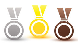 Medals gold silver bronze copper on a red ribbon isolated on white background Stock Photo