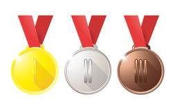 Medals gold silver bronze copper on a red ribbon isolated on white background Royalty Free Stock Image