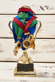 Medals hanging on cup. Royalty Free Stock Photography