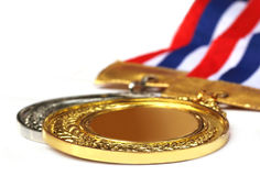 Medals over white background Stock Photos