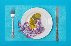 Medals on a plate Royalty Free Stock Photos