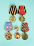Medals after the Second World War. Closeup on light blue background Royalty Free Stock Photography