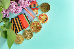 Medals after the Second World War in lilac flowers Stock Image