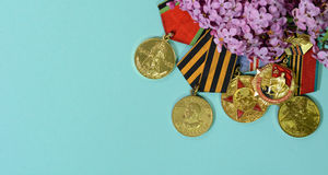 Medals after the Second World War in lilac flowers Stock Photos