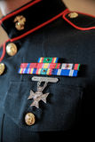Medals on uniform of soldier. Closeup of campaign ribbons and gallantry medal on uniform of soldier royalty free stock photography