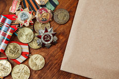 Medals of the USSR and the merits of different years and paper on a table.  selective focus image Royalty Free Stock Photography