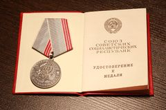 Medals USSR. `The veteran of work`, `For valorous work` with a congratulatory telegram. Medals USSR royalty free stock images