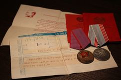 Medals USSR. `The veteran of work`, `For valorous work`. With a congratulatory telegram in Russian language `congratulations on the award stock image