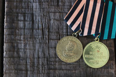 Medals world war great composition. Awards of Merit in World War II by the Soviet Union on a vintage wooden background Stock Photo