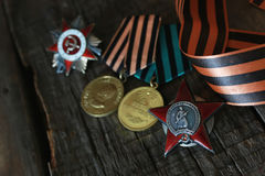 Medals world war great composition. Awards of Merit in World War II by the Soviet Union on a vintage wooden background Stock Image