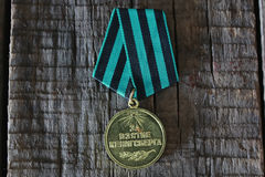 Medals world war great composition. Awards of Merit in World War II by the Soviet Union on a vintage wooden background Stock Photos