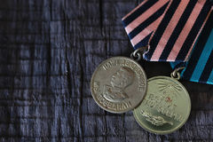 Medals world war great composition. Awards of Merit in World War II by the Soviet Union on a vintage wooden background Royalty Free Stock Photo