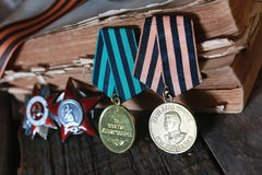 Medals WWII composition. Awards of Merit in World War II by the Soviet Union on a vintage wooden background Royalty Free Stock Images