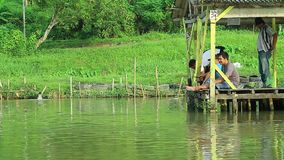 Medan Indonesia 15 December 2019, a group of people are fishing in a fishing pond. Fishing pond stock video footage